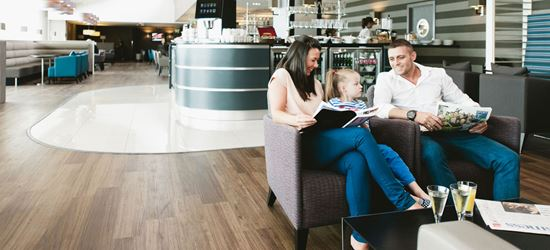A family reading at the Manchester Terminal 1 Aspire Lounge