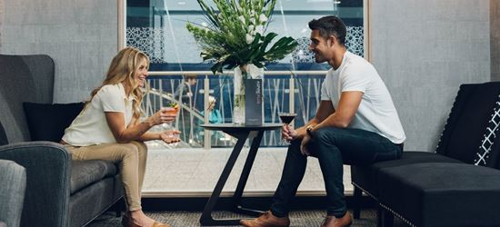 Couple sat in the Bristol Airport AspirePlus Lounge