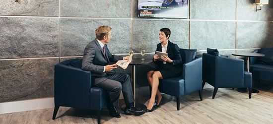 Business Colleagues sat in the Edinburgh Airport Aspire Lounge