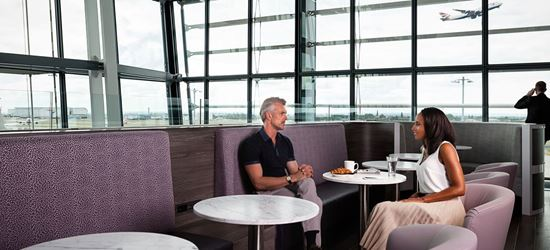 Passengers in the Aspire Airport Lounge at London Heathrow Airport Terminal 5