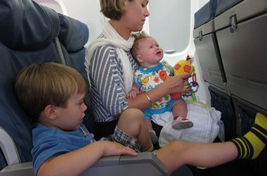 Woman with two children on flight