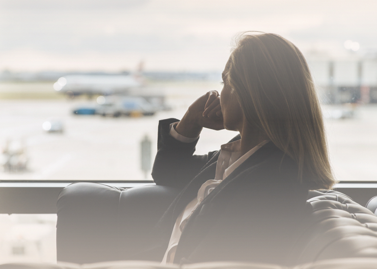 Woman sat in lounge because of flight delay