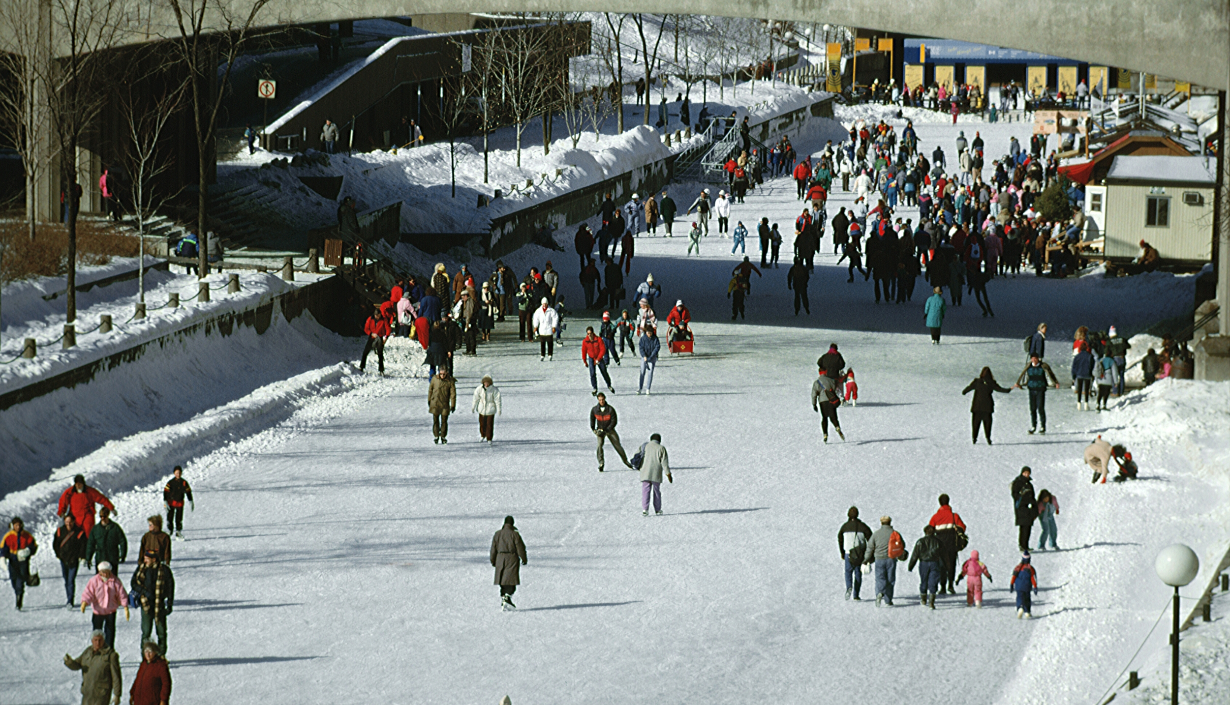 People ice skating at Rideau Canal Skateway in Ottawa Canada